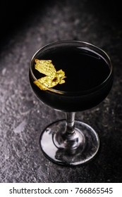 Mysterious Dark Black Mystery Cocktail with Gold Flake