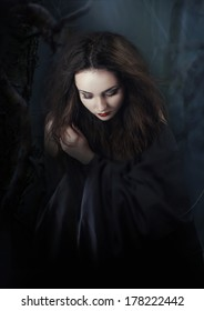 Mysterious dark woman in forest at night. Book cover