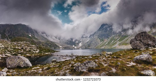 Mysterious Dramatic Scene. View on Hinkovo Pleso Lake with Dramatic Sky. High Tatra. Slovakia. Awecome Nature Landscape. Popular travel and hiking destination. best places in World