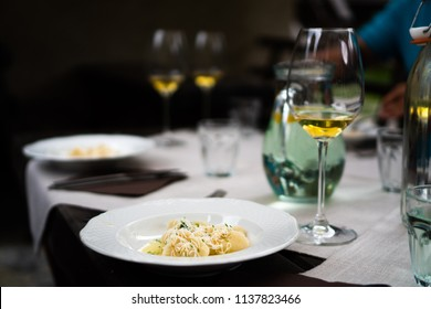 Mysterious fancy dinner with organic orange biodynamic wine and ravioli