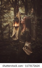 Mysterious fantasy woman with a lantern. Dark and artistic fantasy