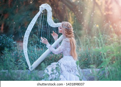 mysterious forest nymph plays on white harp in fabulous place, girl with long blond hair and elegant lace vintage dress calling for bright sun rays, lady with silver jewelry and musical instrument.