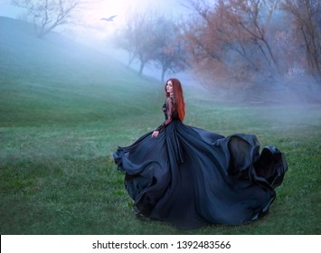 mysterious girl with red hair runs from forest in gorgeous lace royal dress with flying light long train, lady in green frozen meadow and fog, sorceress turns to black crow and flies to sun