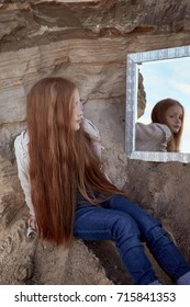 Mysterious girl redhead girl  watch mirrors in the nature