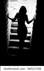Mysterious girl. Sexy woman silhouette. Outlines of a beautiful young woman standing. Black and white silhouette photo of young female.