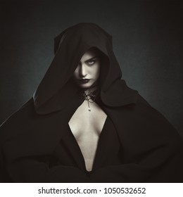 Mysterious hooded vampire woman. Halloween and gothic