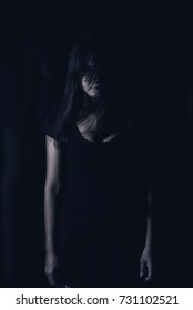 Mysterious, Horror scene of scary woman ghost .Low key /soft focus/ Vintage Film Style Process