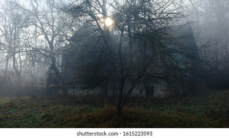 Mysterious house appearing through the thick fog