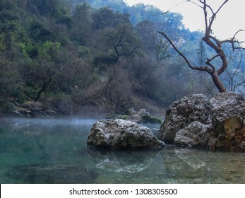 Mysterious landscape with fog around Fontaine de Vaucluse, a spring in a valley at the foot of the Vaucluse Mountains, between Saumane and Lagnes, Provence France