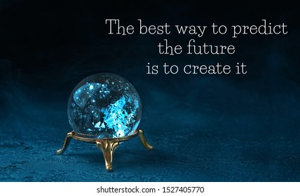 mysterious magic ball predictions on dark background. fortune teller, mind power concept. The best way to predict the future is to create it - motivation quote.