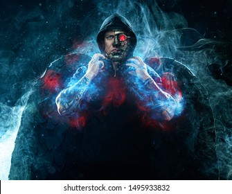Mysterious man in black wear and steampunk mask with wings. Character wizard in robe from the future. Assassin with strong face expression. Fantasy book or computer game cover concept.