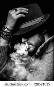 mysterious man in hat vaping