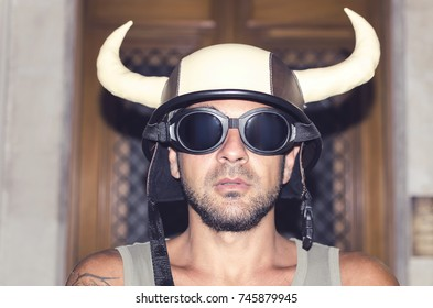 Mysterious man hiding behind mask with black sunglasses and horns.