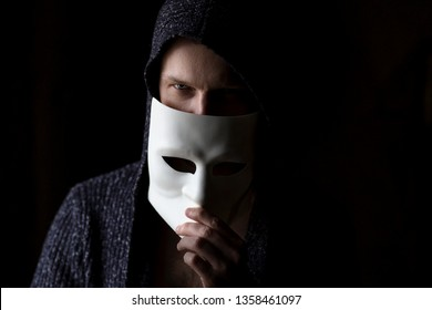 Mysterious man hiding behind white mask