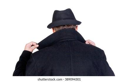 Mysterious man hiding his face behind a raised collar