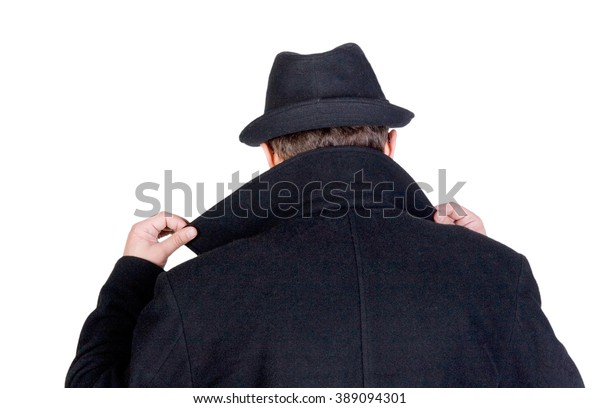 Mysterious man hiding his face behind a raised collar