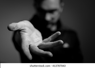 Mysterious man offering his hand