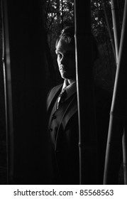 A mysterious man in shadows, black and white