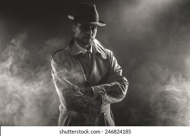 Mysterious man waiting with arms crossed in the fog, 1950s style film noir