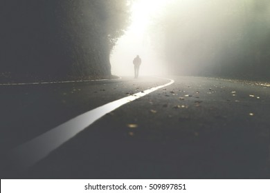 mysterious man walking in the mist