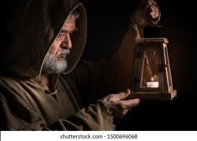 mysterious medieval monk lights lantern