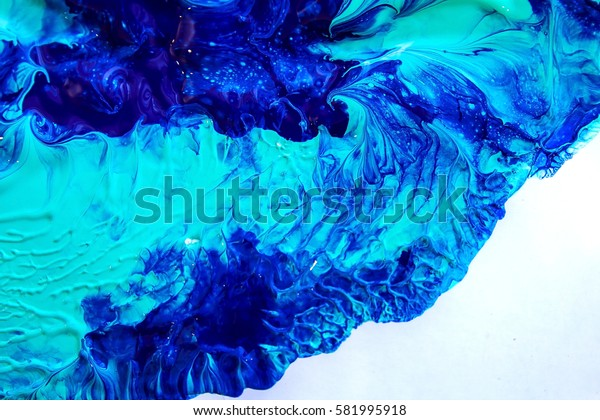 mysterious mix of colors red and blue   / mixing paints