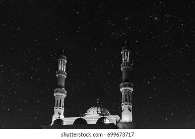 Mysterious mosque in black-and-white color against the background of the starry sky. Dubai, United Arab Emirates
