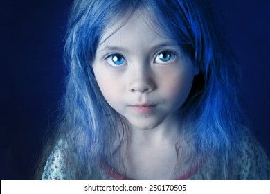 Mysterious mystic girl with blue hair