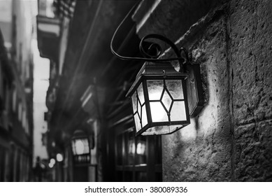 mysterious narrow alley with lanterns in Venice at evening, Italy