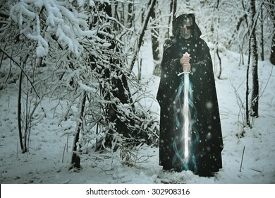 Mysterious old man with magical ice sword . Myth and fantasy