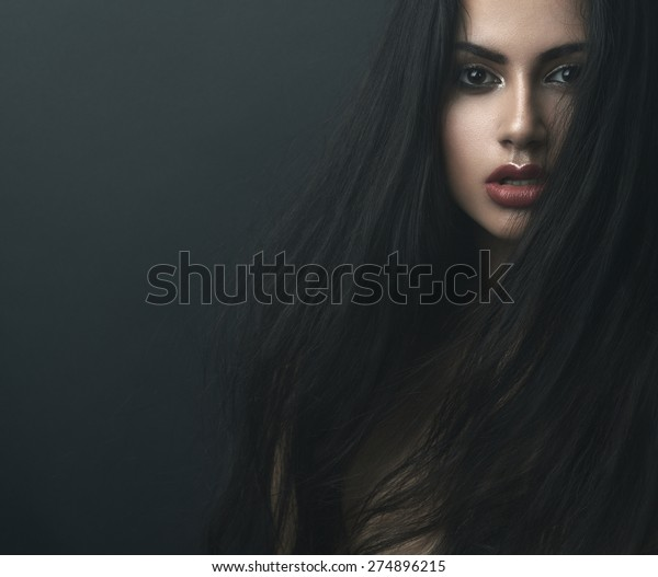 mysterious portrait of a girl in the dark, in the fog