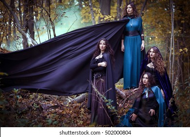 Mysterious portrait. Witch casts a spell. Twilight magic forest. Dark fantasy sorceress woman.Halloween Witch with a magic Pumpkin in a dark forest.  Fairytales. Halloween. Vampire. Gothic.
