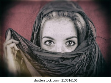 Mysterious Portrait of Young Pretty Blonde Woman Covering her Eyes with a Veil