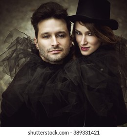 Mysterious romantic couple in black