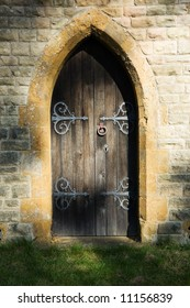 Mysterious semi-circular doorway dappled with a shadowy light