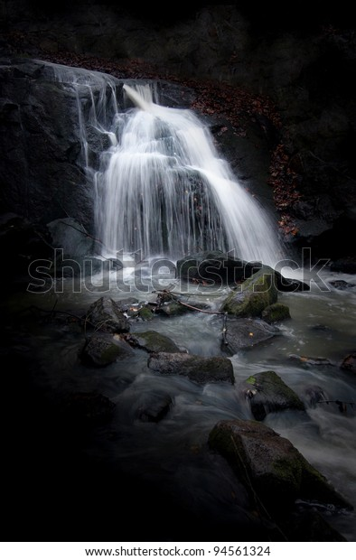 Mysterious Waterfall with dark background.
