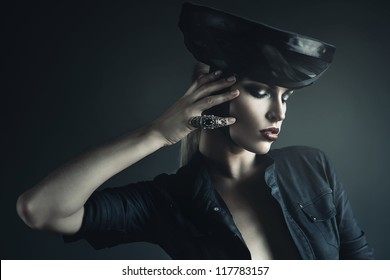 mysterious woman in black with ring