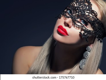 mysterious woman in carnival mask with red lips