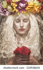 Mysterious woman with flowers behind veil