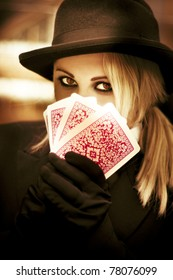 Mysterious Woman Gypsy Fortune Teller Holds Tarot Cards In A Psychic Reading Revealing Future Fortunes