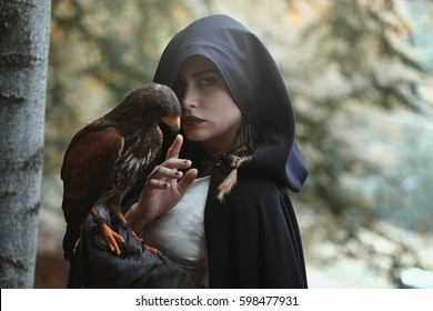 Mysterious woman with hawk. Dark fantasy