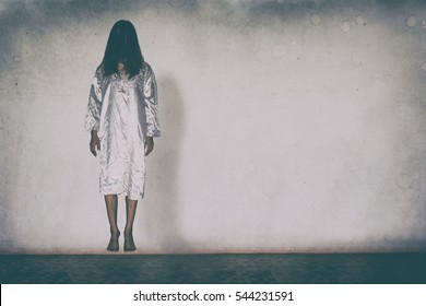 Mysterious Woman, Horror scene of scary ghost woman holding doll on white wall with black shadow