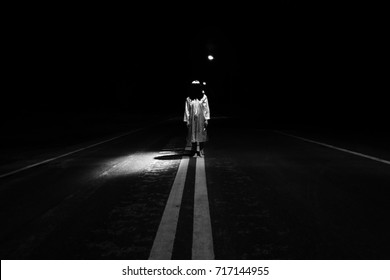 Mysterious Woman, Horror scene of scary ghost woman standing outdoor on street with light in white tone