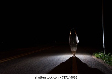 Mysterious Woman, Horror scene of scary ghost woman standing outdoor on street with light