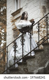 Mysterious woman in a white Victorian dress. The stylized photo at old