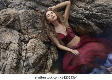 mysterious young beauty on stones