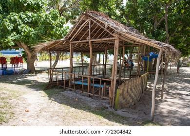 MYSTERY ISLAND,VANUATU/PACIFIC ISLANDS-DECEMBER 2,2016: Rustic shelter, tourists, cruise ship and lush tropical flora at Mystery Island, Vanuatu