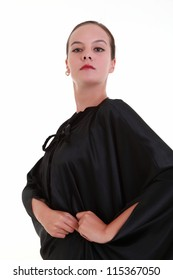 Mystery pretty woman in black mantle with red lips