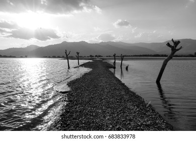 Mystery road across a lake. Black and white