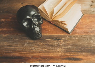 mystic background: black book, skull and candle